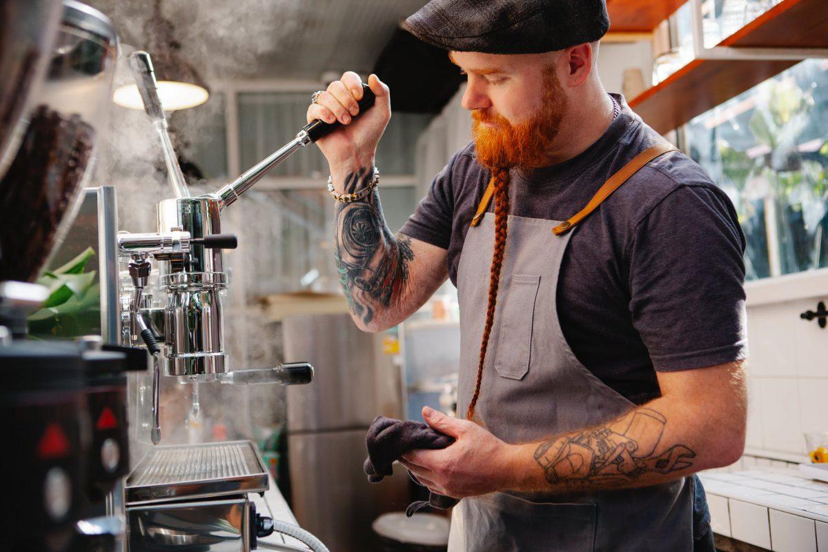 barista preparing coffee machine during work